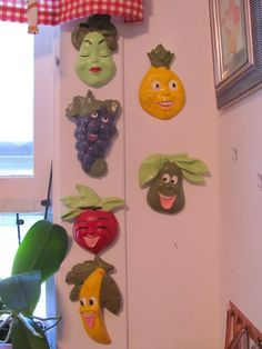6 Kitschy, Anthropomorphic fruit face, chalkware plaques