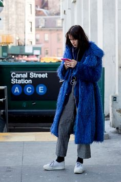 Showgoers Bundled Up In Belted Outerwear On Day 1 of New York Fashion Week. Warmth but make it fashion.