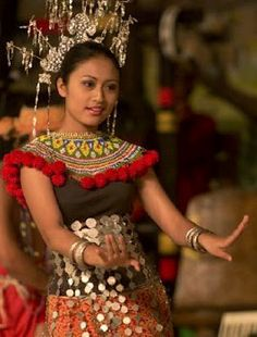 Iban girl performing traditional dance, Sarawak, Malaysia -- The Ibans are native people of Borneo, Sarawak, Malaysia.