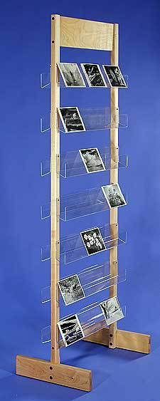 This sturdy free-standing card rack comes in 4 sizes and holds a large number of greeting cards, CDs or other materials. Made in the US from birch plywood and polished acrylic & ready to ship