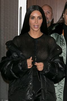 Glammed up: Shortly after arriving in New York, Kim headed out on the town solo following a quick wardrobe change sporting an all-back ensemble and in full war-paint mode