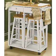 Rolling Kitchen Island With Stools has a drop leaf, two drawers, two towel bars, and would make great use of a small space.