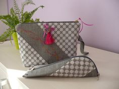 Grey cosmetic bag with pencil case