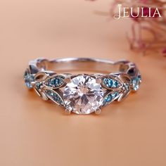 Breathtaking Princess Cut Engagement Rings ❤ Find Your Unique Designer Rings. Be Different. Be Unique. Gorgeous inlay engagement rings, handmade in the US, made just for you. Choose your inlay stone, metal and diamond for a truly unique look. Jeulia Butterfly Round Cut Created White Sapphire with Aquamarine Sidestone Engagement Ring | The Jeulia Jewelry #JeuliaJewelry