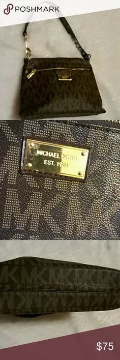 Michael Kors Shoulder Purse This is a Signature Michael Kors Purse. It's in great condition. It is 11 inches wide and 7 inches long. The strap is 19 inches. Zip's up and gold hardware.  Any questions please feel free to ask. Bundle and save. Happy Poshing! Michael Kors Bags Shoulder Bags