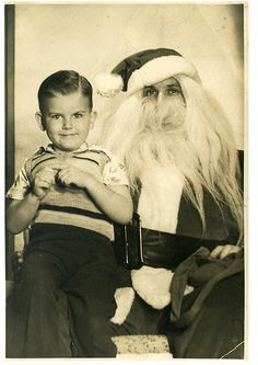 I know the point of this picture is the freaky Santa, but that kid is scaring me!