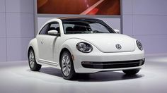 In 2012 Chicago Auto Show, Volkswagen has introduced a new Beetle variant with turbocharged diesel engine. Although this car is using front-wheel drive with 140 hp power, but with its 320 nm of torque makes the beetle can run fast. Françoise Sagan, Fuel Efficient Cars, Chicago Auto Show, Vw Beetles, Diesel Engine, Big Trucks, Car Car, Luxury Cars, Dream Cars