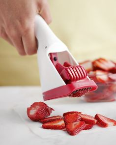 Strawberry Slicer: This cool gadget transforms a whole strawberry into perfect slices with just a press of the handle.