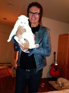 My boy is home. He was hiding in one of the bedrooms. He is so adorable. Pure white... GH