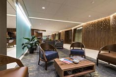 PHOTO TOUR: Chambers Center For Well Being | Healthcare Design --- The calming blue color scheme of the waiting area complements the real walnut wood that's displayed throughout the facility. Photo: Richard Titus Photographics