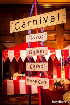 DIY signage attached to 3 ribbon hung up. Inexpensive way to display directional carnival sign.
