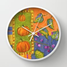 """Pumpkins and Beautyberry Fruits Wall Clock - Available in natural wood, black or white frames, our 10"""" diameter unique Wall Clocks feature a high-impact plexiglass crystal face and a backside hook for easy hanging. Choose black or white hands to match your wall clock frame and art design choice. Clock sits 1.75"""" deep and requires 1 AA battery (not included). $30 NOW $24"""