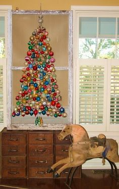 Spindle Christmas Tree: vintage blown-glass ornaments gathered an old window screen
