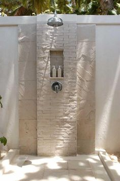 Outdoor Bathroom Design With Outside Showering With White Stones Wall Design For Outdoor Bathroom Ideas The Best Outdoor Bathroom Ideas that You Can Apply at Home Bathroom design http://seekayem.com