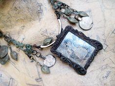 fanci: uruguyan antique frame, artisan mercury glass, kuchi belt components