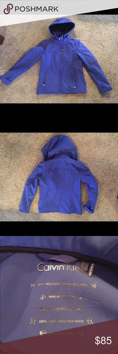 Calvin Klein Women Small purple jacket w/ hood This is an amazing versatile jacket that is great for out and about wind rain or snow. I LOVE LOVE this jacket just need to honor my New Years resolution and clear out. The Purple is just beautiful and has detachable hood and adjustable cuffs and high quality zipper and pockets. Insulated and has kept me warm through windy and cold days. Great used condition now flaws that I can see. Look at the pictures for detail Calvin Klein Jackets & Coats…