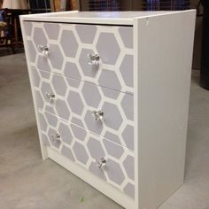I like the idea of doing the beehive/ hexagon look on our filing cabinets