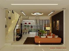 Phòng khách là một điển hình cho sự kết hợp ăn ý của màu sắc khi nhìn từ mọi góc cạnh, chút trắng, chút nâu trầm,  điểm nhấn là màu cam của ghế sofa tạo cảm giác trẻ trung, năng động. Không gian xanh được tận dụng tối đa từ trong phòng khách cho đến chỗ bếp nhìn ra hiên không những cho kiến trúc đẹp hơn mà cho gia chủ cảm giác trong lành như đang được hoà mình vào thiên nhiên. Living Room Partition Design, Room Partition Designs, Living Room Tv Unit Designs, Ceiling Design Living Room, Interior Design Your Home, Home Stairs Design, House Design Photos, Minimal House Design, Small House Design