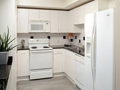 Contemporary Kitchen with European Cabinets, Large Ceramic Tile, Natural Hues Ceramic Floor & Wall Tile, Drop-In Sink, Flush