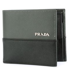This beutiful Prada 2M0738 Saffiano Mens Leather Wallet is a Sleek and elegant signature Prada bi-fold wallet Made out of black/grey saffiano leather. at $149.00  http://www.bboescape.com/products/buy/871/gifts/Prada-M-Saffiano-Mens-Middle-Logo-Leather-Wallet-with-Coin-Pocket-Black-Grey