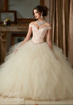 Morilee Vizcaya Quinceanera Dress 89102 BEADED LACE ON A RUFFLED TULLE BALL GOWN Matching Stole. Available in Coral, Scuba Blue, Champagne/Blush, White (Color of this dress): Champagne/Blush