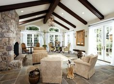 on a smaller scale - this would be a great dining room addition to the house - love the beams, doors & windows