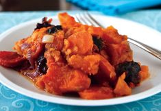 A Vegan Passover - Sweet Potato Tzimmes. Ingredients: olive oil, red onion, carrots, sweet potatoes, pear, dried prunes & apricots, orange juice, cinnamon, fresh or jarred ginger, salt, nutmbeg, chopped walnuts (optional)