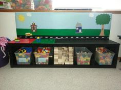 Find on Facebook at Nik's Summit Playschool. Felt board, Duplo center and block center we made from an IKEA bookshelf! Space saving for a small home daycare or childs playroom!