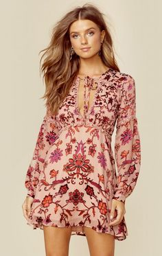 b1076742f8 The For Love and Lemons Saffron Mini Dress features a gorgeous floral  embroidery throughout