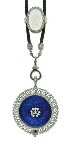Cartier Art Deco diamond, platinum and rock crystal slide enhancer on a black silk cord featuring a wonderful Husson pendant watch in platinum, diamond, enamel.