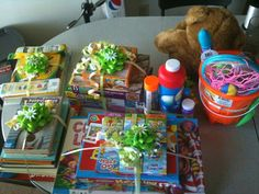 Hot Mess Housewife: Fiesta Friday: A Foster-Parent Shower of Love - centerpieces are games/toys for child
