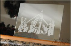 Beautiful Nativity! Looks like etched glass, but it's vinyl. Such a great idea.