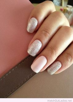 Glitter on grey and light pink nail polishes