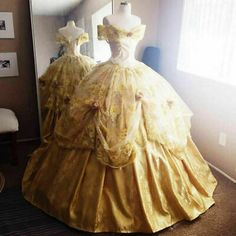 Disney Inspired Deluxe Belle Ball Gown from Beauty and the Beast You will literally be the Belle of the ball in this amazing gold gown inspired by the Disney classic Beauty and the Beast! Robes Disney, Disney Dresses, Ball Dresses, Ball Gowns, Women's Dresses, Dresses Online, Fashion Dresses, Gold Evening Dresses, Party Gowns