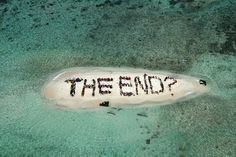 """Hundreds of Belizeans gathered on Sergeant's Caye, November 2010, to form a human banner to send a message to the COP UN Climate Change meeting in Cancun - """"We formed the words 'The End?' with a question mark. So if we don't change some fundamental aspect of the way that we run the planet, the business as usual scenarios in the climate change IPPC reports, business as usual will see the end of coral reefs by the end of this century."""""""