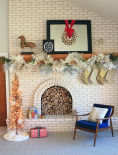 christmas mantle. love that fireplace too