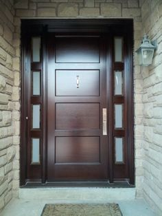 This #Amberwood custom mahogany 4 panel #door looks stunning against this home's light stone work!