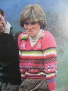 May 06, 1981: Lady Diana Spencer at Craigowan Lodge on the Balmoral Estate, Scotland, with Prince Charles and his labrador dog Harvey. Wearing an Inca inspired pink/red striped and patterned sweater with llamas or alpacas at the top, corduroy trousers and wellington boots.