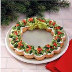 Christmas Appetizer Wreath. This looked too pretty to eat... but eventually someone made the first move! next time I plan on cutting the crescents in half so there isn't too much bread and making two wreaths out of it.