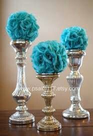 Teal floral arrangements with silver candleholders