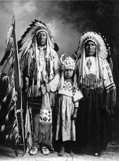 Two Blackfoot men and one boy, but no names, date, location or relationships...