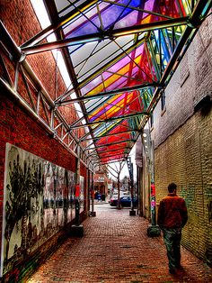 RAINBOW: Central Square alley way - Bansky come back and seek shelter from the storm here.