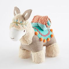 The Leo Llama Plush is soft and snugly made with faux fur and herringbone fabrics. Leo Llama comes complete with a Security Blanket in a Moroccan inspired pattern. The perfect boho friend for your little one!