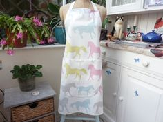 These are handmade by me and can be made to order. They are 100% cotton (hard wearing) with a front pocket. They are 78cm x 68 cm approximately (adult) but I can make any size , including children's aprons for various prices. The apron now has D-Rings with an adjustable neck strap, ( not shown in main picture) if you would rather have an ordinary strap please message me when ordering Washing instructions are a 30c wash with a cool iron , I find this very satisfactory. We can now post…