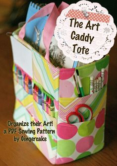 Art Caddy Tote PDF Pattern Ebook organize your art crayons pencils pads paints  Now that kids are heading back to school and their inside activities, they could really use something like this adorable art supply tote to help them get organized! The pattern is available on Etsy from Gingercake Sewing for $7. The choice of fabric really makes a dramatic difference in the look, and can easily make this tote work for a boy or a girl.  #sewing #sewingprojects