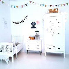 Scandinavian kids room with white walls, floor, and furniture.