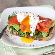 Open-faced egg sandwich with smoked salmon, avocado, and arugula for weekend brunch!