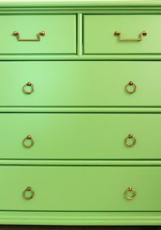 green dresser with mismatched hardware. Benjamin Moore Bunker Hill Green