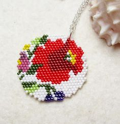 A pretty little peyote pendant from Evi!