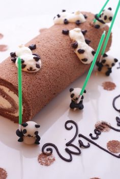 I don't even know what's going on here, but I love it! Roll cake with Pandas holding light sabers?